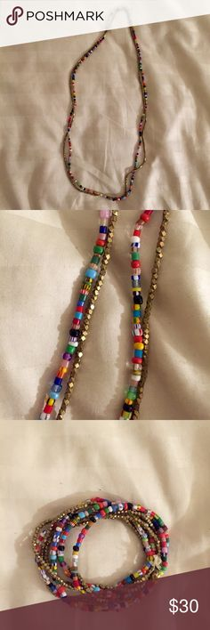 African Glass and Metal Beaded Necklace I bought these beautiful beaded necklaces in Martha's Vineyard from a shop that sells African art and jewelry. The colorful beads are blown glass, and the little gold faceted beads are some type of metal (brass perhaps). They are strung on string and knotted and secured with wax at the knot. I am selling them as a pair because they look so beautiful together! These necklaces are lovely and delicate and can add something special to many different…