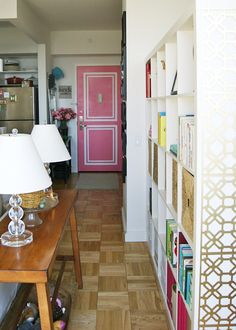 Small apartment organization and a sweet pink door. Loving the colors and patterns in this New York apartment! | Photos by meredithandthenewyorkie.com