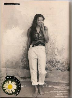 Kate Moss wearing rolled up white Levi's as styled by Melanie Ward for The Face by Corinne Day 1990.