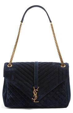Loving this classic suede YSL shoulder bag in a rich navy suede with gold hardware.