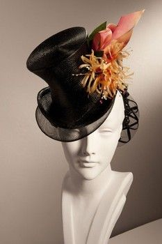 These gorgeous hat designs are from legendary milliner Stephen Jones. This is just a sampling of his amazing creations. A beautiful black topper with coral and gold accents.