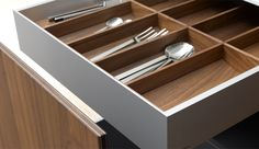 butlhaup b3 cutlery tray inserts in an internal pull out drawer. Look closely at the unit door and you will see it is made of solid walnut with two sheet of aluminium sandwiched in between!