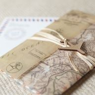I ABSOLUTELY HAVE TO HAVE THIS!!! Vintage Air Mail Wedding Invitation - Wrapped w/ a vintage map of your location  sealed w/ raffia  a wooden airplane, this invite is sure to convey the vintage travel theme of your wedding  even the mailing envelope is printed w/ the air mail look  your guests will love getting this in their mailbox!