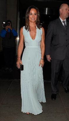 Kate Middleton's pretty sister looked a bit baked (as in overly tan!) while wearing a light blue Hugo Boss dress to the ParaSnowBall party in London.