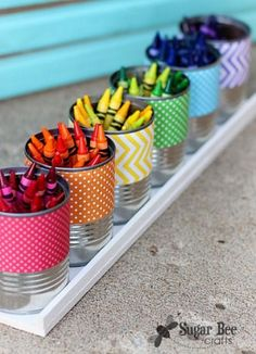 Organize all the kids'€™ crayons with bright patterned tins for the classroom. Wrap cans with a strip of scrapbook paper, one for each color of the rainbow.  I secured it to the can with hot glue.