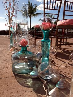 Along the aisle, tall glass cylinders were placed and filled with water and glass orbs, some submerged and some floating. This is so different.