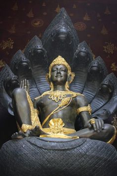 Lord Vishnu, 1st Deity of the Indian Trinity: the Lord maintainer of all the universes resting/sitting on and supported by Lord ananta-Sesha (who controls universal laws such as gravity).