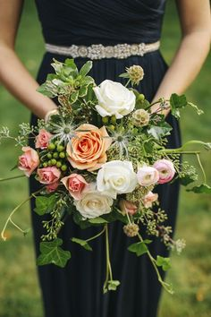 Gorgeous bridesmaid's bouquet from the bride's family friend Tom Bryant and bride's aunt, Sarah Ihlenfield   via http://junebugweddings.com