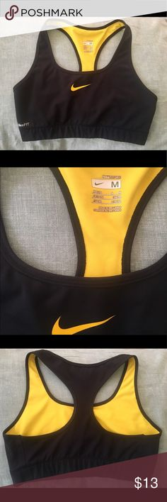 """Nike Classic Sports Bra in black w/ yellow Black with a golden yellow swoosh, as well as gold-yellow inside lining. Great for running, yoga, workouts at the gym, cheer practice - you name it! Considered """"medium-support"""" or medium impact. Not padded! Fits about 36 band size. Only gently worn. Selling because it no longer fits me :/ From a smoke-free and pet-free home. Nike Intimates & Sleepwear Bras"""