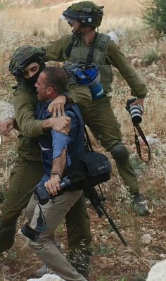 Israeli soldiers broke photo journalist's cameras, then he was beaten up by six soldiers. Seems they don't want photos of the truth about their crimes seen by the world. West Bank , June 6-14