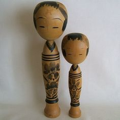 pair of vintage kokeshi with lovely decoration