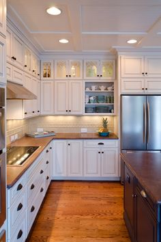 I can't decide which element I love more, the decorative ceiling details or the top glass cabinets. www.lanebuilt.com