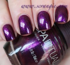 Scrangie: Christmas SpaRitual Shooting Star. I can't decide which one I love more- Shooting Star or Blue Moon? They're similar types of polishes, but there's a little more sparkle in this one. Shooting Star has a dark royal purple shimmer base and lots of large, chunky purple-pink-red-gold duochrome shimmer. It's so glowy and lively looking, I personally think this is a must-have if you love purple.