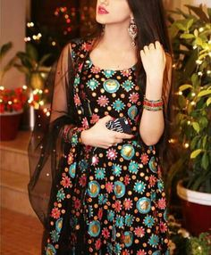 Raspberrily pouting dark chocolette in sleeveless midnight floral A-line dress w/ sheer black shawl