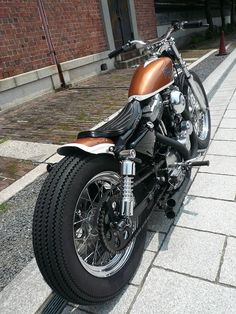 Copper & white Evo Sportster swingarm custom by Gravel Crew | right rear
