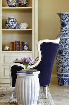 South Shore Decorating Blog: A Random Collection on Eclectic, Traditional, and Transitional Rooms  NOW THAT'S A VASE! LOVE THE CHAIR.