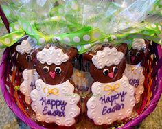 Sweet little lamb cookies by The Painted Cookie in cello and polka dot ribbon.