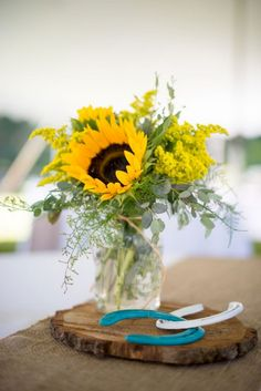 Beautiful Sunflower Arrangement Center Pieces Easy To Make It <br> There are a number of different kinds of centerpieces to choose from. As the centerpiece is the focus of the baby shower, it's very critical that you design or buy the best one. Sunflower Wedding Centerpieces, Sunflower Arrangements, Sunflower Bouquets, Mason Jar Centerpieces, Wedding Bouquets, Mason Jars, Wedding Flowers, Wedding Decorations, Cowboy Boot Centerpieces