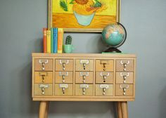 Hey, I found this really awesome Etsy listing at https://www.etsy.com/listing/201809997/mid-century-wooden-library-card-catalog