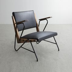 Lina Bo Bardi and Giancarlo Palanti; Iron, Wood and Leather Lounge Chair for…