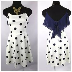 """White & Blue Polka Dot Bow Skater Dress Small ‼️PRICE FIRM‼️   Size Small  Really fun, comfortable and fashionable dress.  Popular nautical look with navy and white polka dots. Lots of stretch to this dress for a super comfortable fit.  Lightweight and perfect for spring and summer!  Fully lined.  83% polyester, 14% rayon, 3% spandex.      Bust 30""""-34""""  Waist up to 31""""  Length of garment 30"""" Rachel Kate Dresses"""