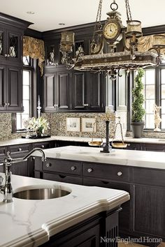 Dark cabinets with white countertops