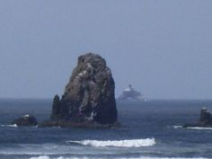 Needle near Haystack Rock at Cannon Beach, Oregon.  Tillamook Rock in the distance.  A Travel Guide to Murder