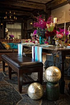 Rich and elegant dining space with bohemian details and colorful table setting