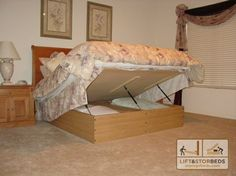 Great idea. Lift up storage bed. This site sells DIY kits with instructions.
