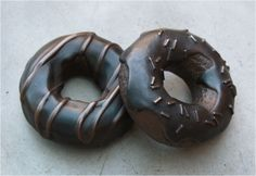 Paper weight sculpture are hand painted in two versions; sprinkled or glazed. Optional steel donut box holds up to 4 donuts. Bedside Clock, Chocolate Donuts, Table Accessories, Paper Weights, Candle Holders, It Cast, Bronze, Santa Monica, Michigan