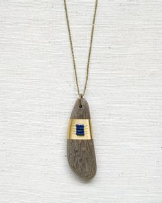 Driftwood Amulets with Lapis by SeeRealFlowers on Etsy