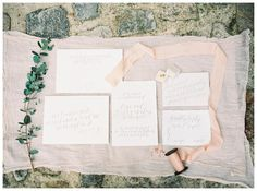 Wedding invitation suite on deckle edge paper with graceful gray calligraphy by Stephanie Bobruska. Soft peach ribbon by Silk & Willow. Ring with leaf detail by Emi Jewels in velvet ring box from The Mrs. Box. Image by Shannon Moffit.