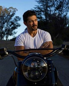 Hot bike, then hot guy...in that order of course....;)