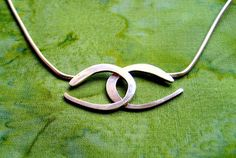"""Silver necklace with two """"C's"""""""
