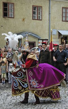Lajkonik, one of the unofficial symbols of Krakow. It is represented as a bearded man resembling a Tatar in a characteristic pointed hat, dressed in Mongol attire, with a wooden horse around his waist. The city has now banned the everyday presence of the lajkonik in the Main Market Square. It is the subject of the Lajkonik Festival (Polish: Lajkoniki) that takes place each year on the first Thursday after the religious holiday of Corpus Christi (in June)