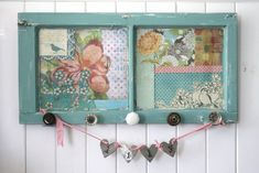 Gorgeous upcycle from a small window to coat hanger.  Backed with papers.