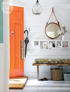 orange door, plank walls, wood entry bench with chiang mai cushion