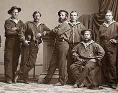 Group of Sailors, United States Navy, in Civil War Navy Uniforms. It was taken between 1860 and 1865.