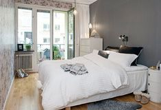 Bedroom with grey wall and white bedding. 60 Unbelievably inspiring small bedroom design ideas