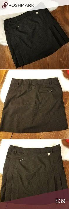 (Greg Norman) Black Tennis/Golf Skirt Greg Norman. Black Tennis / Golf Skirt. Excellent used condition.   Pleats. Lined. Many pockets.   Size 6. Greg Norman Skirts Mini