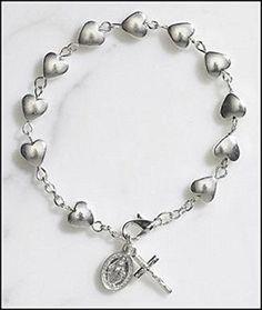Silver Tone Heart Rosary Bracelet w/ St Mary Miraculous M... https://www.amazon.com/dp/B00E3CQXHK/ref=cm_sw_r_pi_dp_x_IDnhybHHN33SW