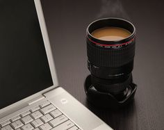 Coffee mug that looks like a camera lens, for only $15. My friend has one of these, and it's so darn cool! Want want want.