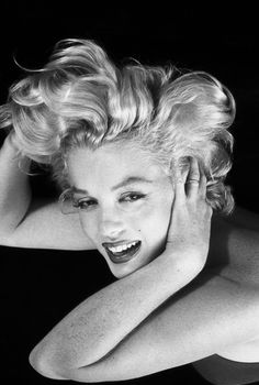 Marilyn Monroe. Little if any retouching (note the freckled arms!). As Helmut Newton said, a photograph is most powerful when it's least tampered with. KA