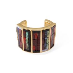 """This statement cuff is inspired by ancient tile work and cobbling techniques. The beauty is in the collaging of imperfect semi-precious stones within a clean antique gold metal setting. The weightiness of this piece speaks to its substantiality.Sodalite, onyx, red jasper, brecciated jasper, chyrsoprase, aventurine, brassMeasures 2.5"""" interior diameterALL SALE ITEMS ARE FINAL SALE"""