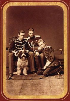 Sons of Emperor Alexander II – Grand Dukes Paul Alexandrovich (with a doggy) and Sergei Alexandrovich. Baron Shilling sits on the floor. 1879. #Russian #history #Romanov