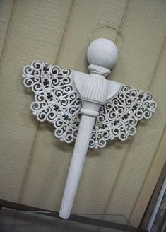 The body is from half of an old table leg. The head is half of a ball top of a bed post. And the wings are from half of some big plastic thing -- maybe a clock?