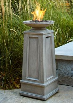 This ventless fireplace is a dramatic addition to any patio or porch. Fire Pit Wall, Fire Pit Decor, Fire Pit Chairs, Fire Pit Seating, Seating Areas, Porches, Fire Pit Heater, Patio Heater, Fire Pit With Rocks