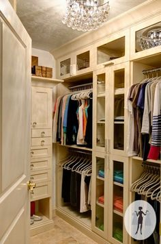 Organized Closet - a well-lit closet with lots of space for hanging and folded clothes, plus closed cabinetry which makes it look less cluttered - The Zhush