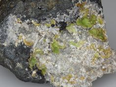 Koritnigite, ZnHAsO4•(H2O), and Attikaite, Tsumeb Mine, Tsumeb, Otjikoto Region, Namibia. The inter grown mineral phases vary in colour from a light yellow green to a pastel creamy yellow, with a waxy lustre. The minerals having formed on Quartz lined cavity. The matrix is a metallic grey sulphide inter-grown with Pyrite
