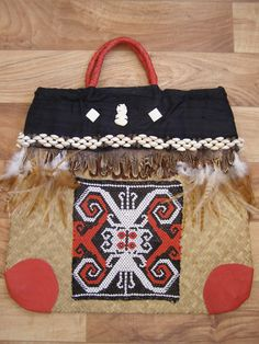 My best Kit Bag with traditional Maori bead weaving,feathers,silk lining and leather. This bag only goes out on special occassions.